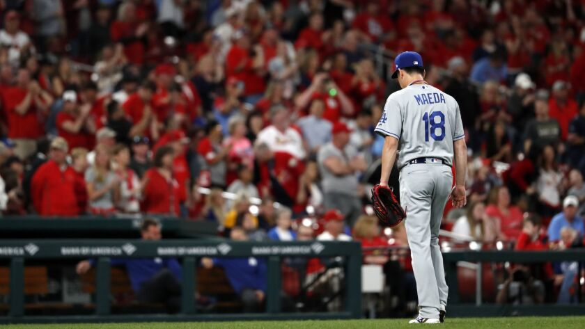 Los Angeles Dodgers starting pitcher Kenta Maeda leaves the baseball game after giving up a two-run