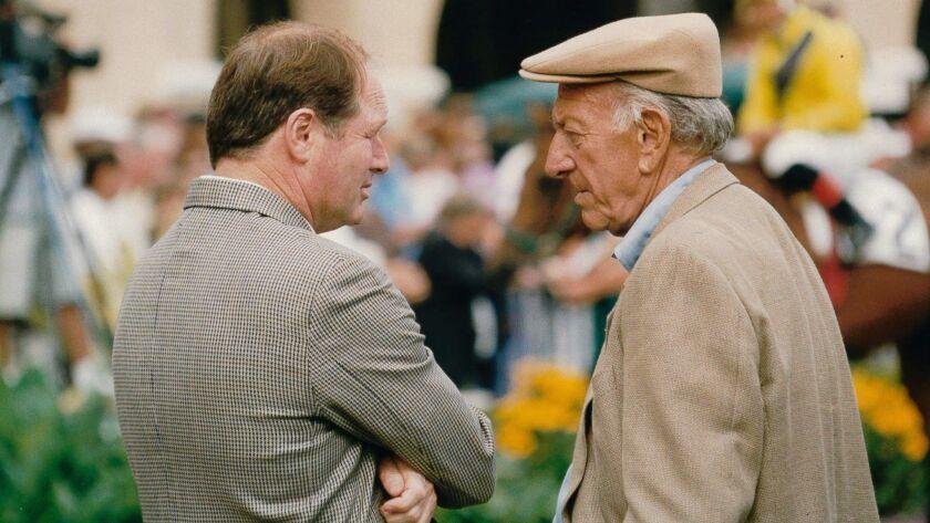 Trainer Richard Mandella and Jack Klugman talk in the Del Mar paddock in 1999.