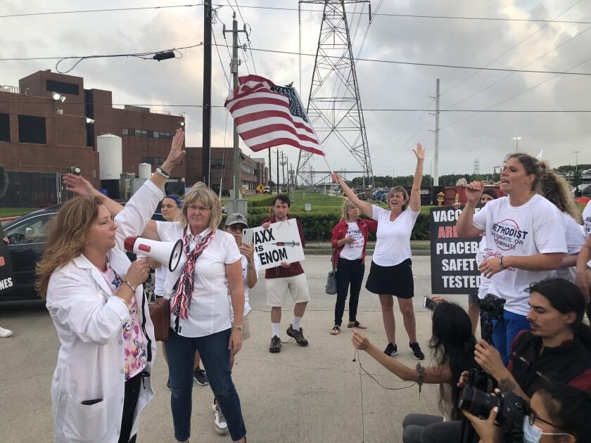 Houston Methodist Hospital nurse Jennifer Bridges, right, leads a COVID vaccine protest
