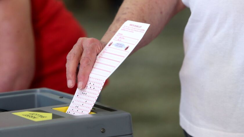 A voter casts his ballot at the Buena Vista Library polling location in Burbank on Tuesday, Nov, 6,
