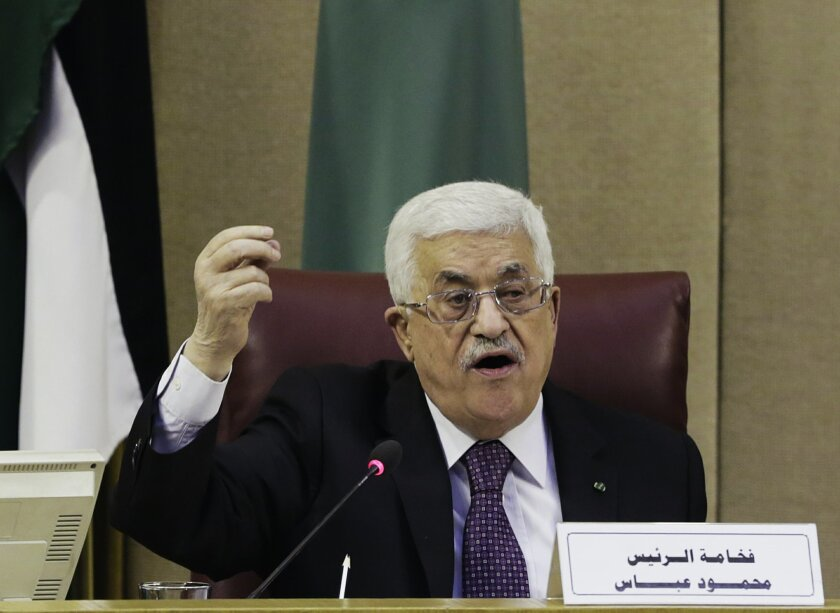 """Palestinian President Mahmoud Abbas speaks during an Arab foreign ministers meeting at the Arab League headquarters in Cairo, Egypt, Thursday, Jan. 15, 2015. Abbas asked the Arab League to provide a """"safety net"""" of $100 million a month to cover tax revenues withheld by Israel in retaliation for his"""