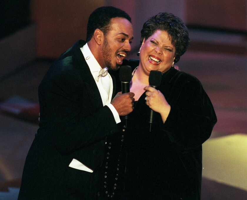 James Ingram, left, performs with Patti Austin in Pasadena in 1997. Ingram's death was announced Tuesday.
