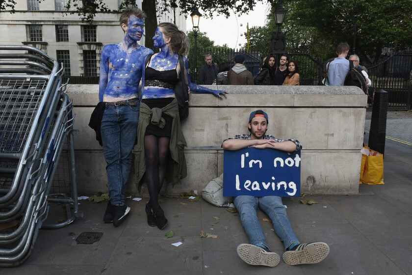 A young couple painted as EU flags protest outside Downing Street in London on June 24, 2016. They opposed Britain's decision to leave the EU.