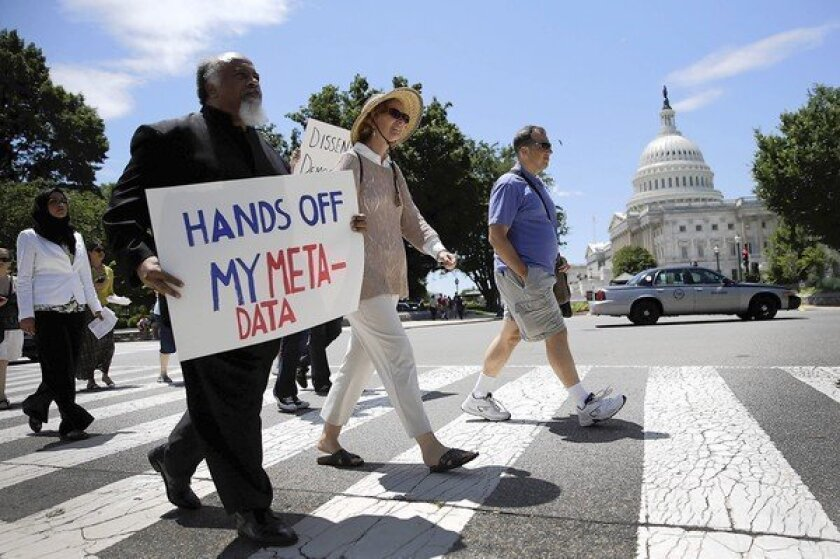 Protesters rally at the Capitol in opposition to the National Security Agency's surveillance programs.