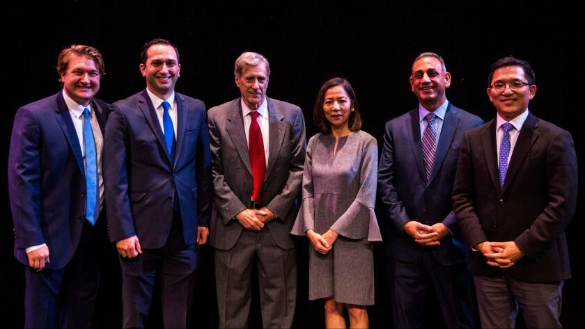 Candidates Phil Janowicz, Sam Jammal, Andy Thorburn, Mai-Khanh Tran, Gil Cisneros and Jay Chen at Fullerton College in January.