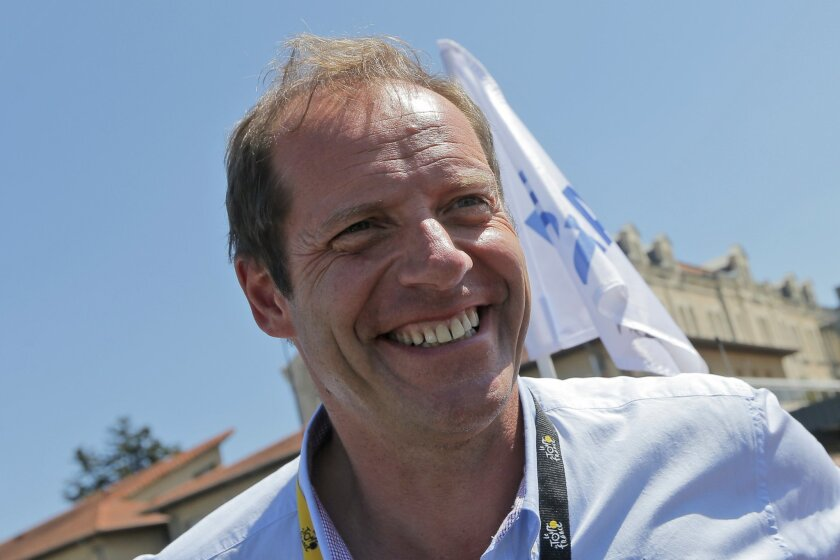 Tour de France director Christian Prudhomme smiles prior to the start of the sixteenth stage of the Tour de France cycling race over 201 kilometers (124.9 miles) with start in Bourg-de-Peage and finish in Gap, France, Monday, July 20, 2015. (AP Photo/Christophe Ena)