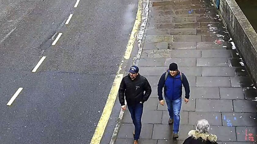 Russians Ruslan Boshirov, left, and Alexander Petrov walk in Salisbury, England, on March 4, 2018, in a CCTV screen grab. Britain says they're agents behind the poisoning of a former Russian spy. The men say they were just visiting the city to see its cathedral.
