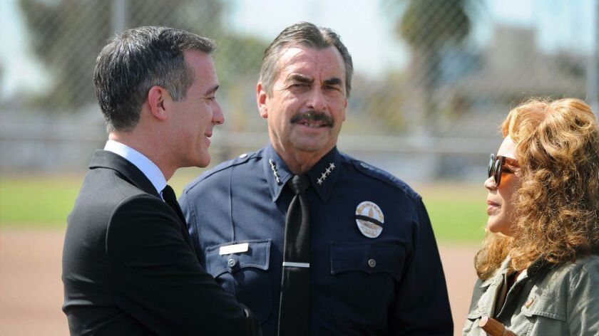 LAPD Chief Charlie Beck, center, said Tuesday that reports of sexual assault and domestic violence among the city's Hispanic population have dropped this year, as a climate of fear grips the city's immigrant population.