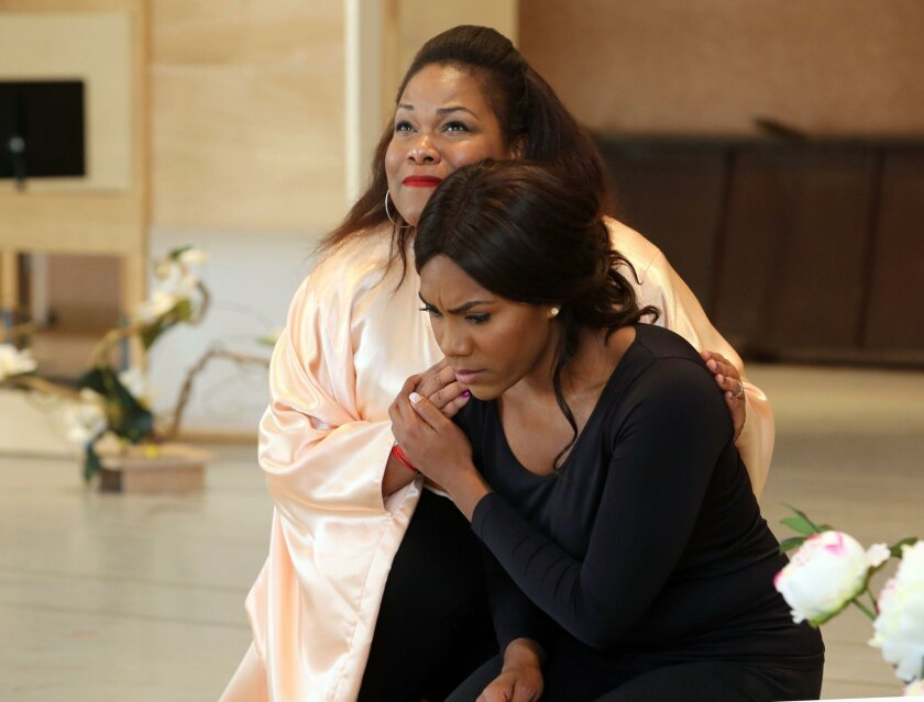 """J'nai Bridges, front, playing Suzuki and Latonia Moore playing Madame Butterfly during a rehearsal for the upcoming San Diego Opera production of """"Madama Butterfly."""""""