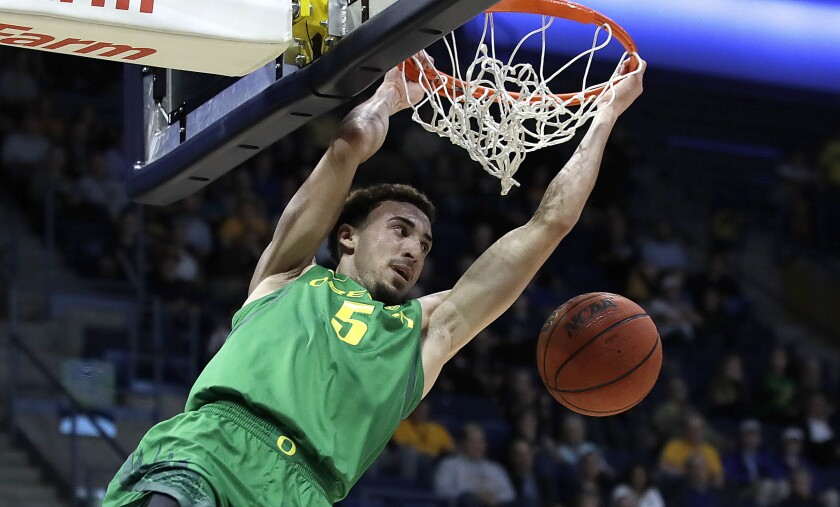 FILE - In this Jan. 30, 2020, file photo, Oregon's Chris Duarte scores against California in the first half of an NCAA college basketball game in Berkeley, Calif. Duarte is The AP Pac-12 player of the year and a member of the All-Pac 12 first team, announced Tuesday, March 9, 2021. (AP Photo/Ben Margot, File)