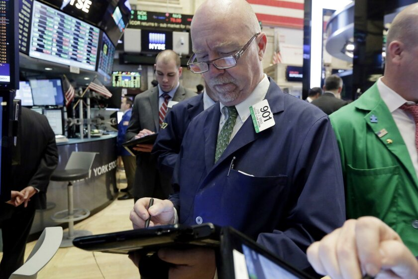 The Bloomberg San Diego County Index grew by 1.19 percent in April. Pictured: Trader John Doyle, center, works on the floor of the New York Stock Exchange, Tuesday, May 24, 2016.