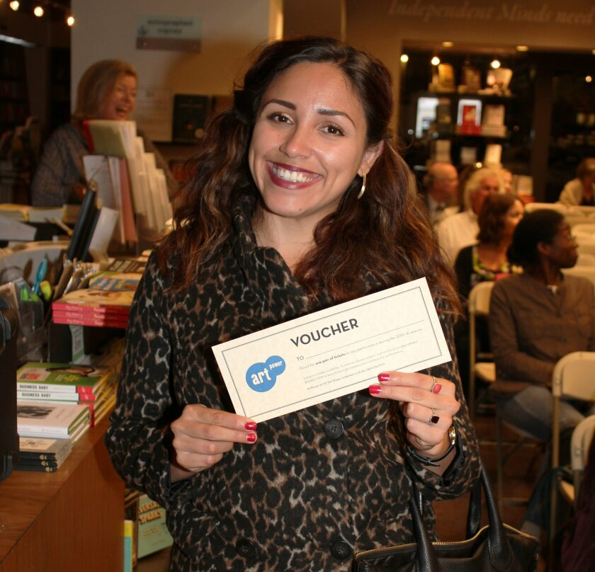 Attendee Elena Buenrostro displays a gift certificate to an ArtPower! performance of her choice that she won in a post-event raffle.