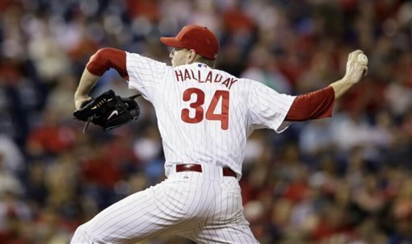 Philadelphia Phillies' Roy Halladay pitches during the third inning of a baseball game against the Washington Nationals, Wednesday, Sept. 4, 2013, in Philadelphia. (AP Photo/Matt Slocum)