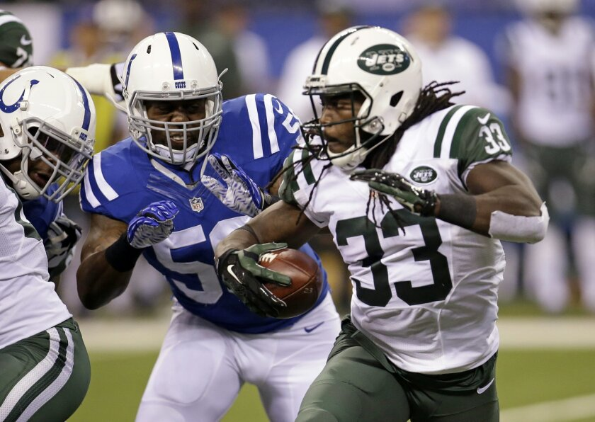 Indianapolis Colts outside linebacker Trent Cole (58) chases New York Jets running back Chris Ivory (33) in the first half of an NFL football game in Indianapolis, Monday, Sept. 21, 2015.  (AP Photo/AJ Mast)