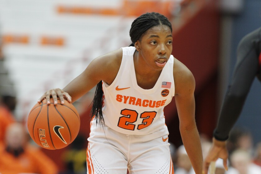 Syracuse's Kiara Lewis looks to pass the ball in the first quarter of an NCAA college basketball game against Louisville in Syracuse, N.Y., Sunday, Feb. 9, 2020. (AP Photo/Nick Lisi)