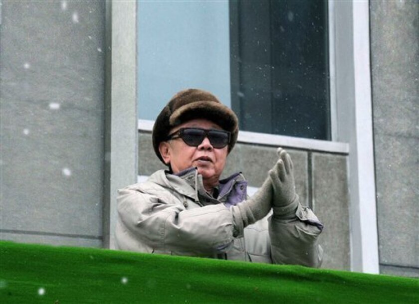 In this photo released by Korean Central News Agency via Korea News Service in Tokyo on Sunday, March 7, 2010, North Korean leader Kim Jong Il claps during a massive rally Saturday, March 6, 2010, marking the completion of the Vinalon Complex, in Hamhung, North Korea. (AP Photo/Korean Central News Agency via Korea News Service)