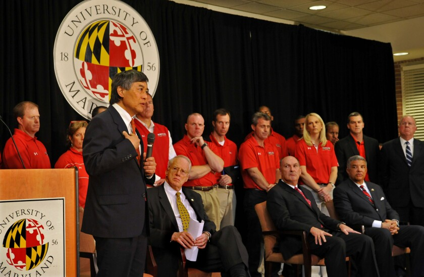 University of Maryland President Wallace Loh, left, in 2012. On Wednesday, he said a school computer database containing names and Social Security numbers had been hacked.