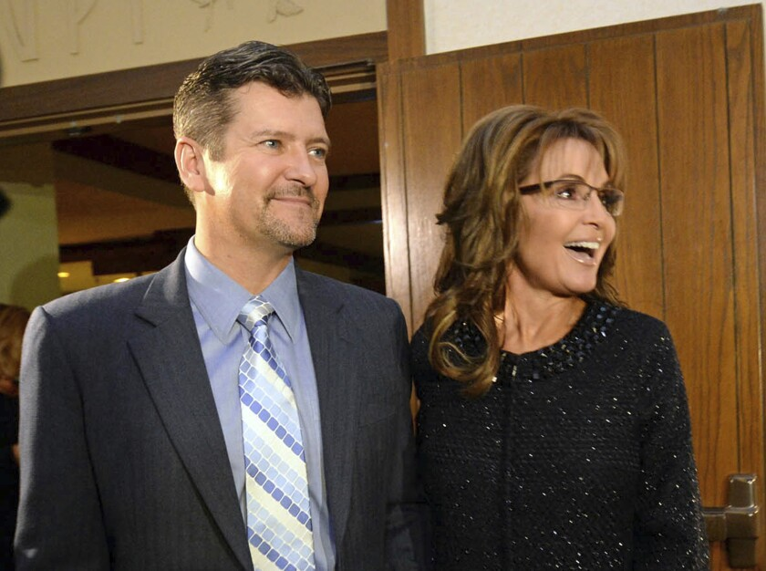 FILE - In this Nov. 7, 2013 file photo, former Alaska Gov. Sarah Palin and her husband Todd arrive at the Grove Park Inn for a celebration of evangelist Billy Graham's 95th birthday in Asheville, N.C. Sarah Palin says she found out her husband was seeking a divorce from his attorney. The revelation came in an interview released Tuesday, Nov. 12, 2019, with James Dobson, founder of the Family Talk Christian ministry. (AP Photo/The Charlotte Observer, Todd Sumlin, File)