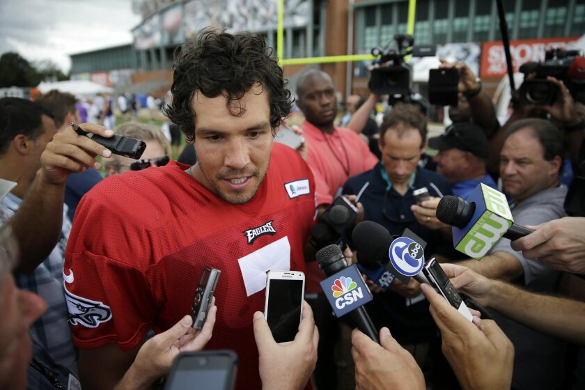 Philadelphia Eagles quarterback Sam Bradford speaks with members of the media after NFL football training camp, Thursday, Aug. 20, 2015, in Philadelphia. (AP Photo/Matt Rourke)