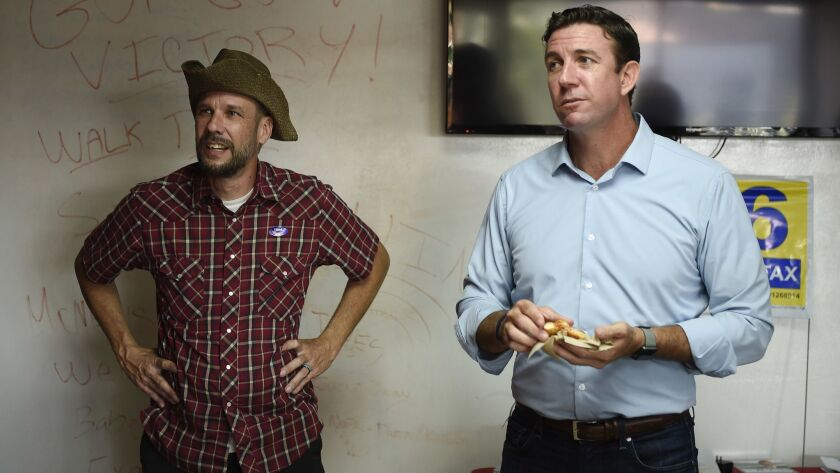 U.S. Rep. Duncan Hunter, R-Calif., right, stands next to a campaign worker at a call center on Tuesd