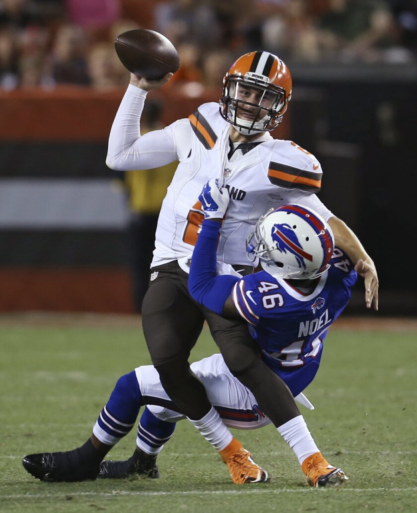 Buffalo Bills cornerback Merrill Noel (46) sacks Cleveland Browns quarterback Johnny Manziel during the third quarter of an NFL preseason football game, Thursday, Aug. 20, 2015, in Cleveland. (AP Photo/Ron Schwane)