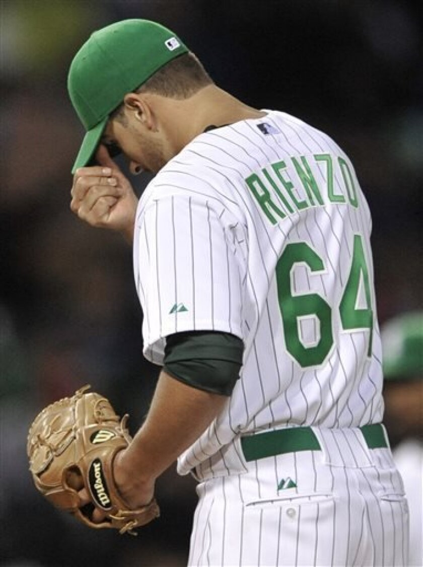 Chicago White Sox starting pitcher Andre Rienzo reacts to giving up two home runs during the fourth inning of a baseball game against the Cleveland Indians in Chicago, Saturday, Sept. 14, 2013. (AP Photo/Paul Beaty)