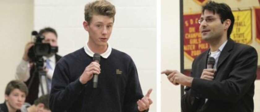 Bishop's School sophomore Joseph Ramirez-Cardenas (left) poses a question to Mark Wexler (left), executive director of the nonprofit organization Not For Sale, which works to combat human trafficking and slavery around the world.