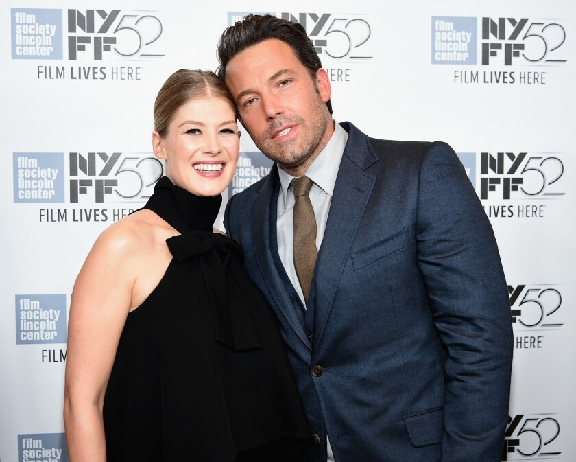 Actors Rosamund Pike and Ben Affleck attend the opening night presentation of 'Gone Girl' at the New York Film Festival.