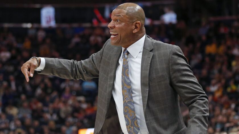 Coach Doc Rivers says he's staying put on the Clippers' sideline.