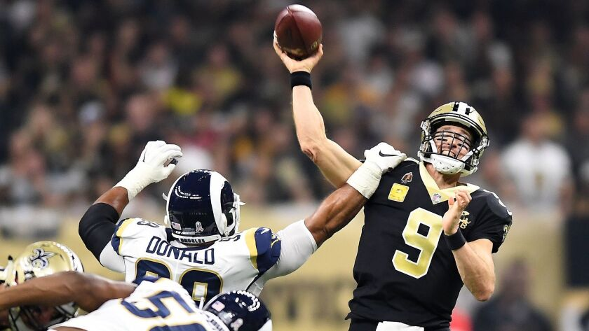 Rams Aaron Donald gets an arm on Saints quarterback Drew Brees (9) at the Mercedes Benz Superdome in Week 9 of the NFL regular season.