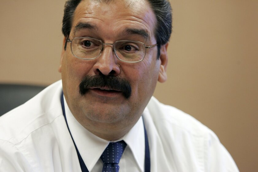 December 4, 2006, San Diego, CA_National City Police Chief ADOLFO GONZALES (CQ), explains the acquisition of a 1989 Brinks armored vehicle that the city purchased for $10 cash and will retrofit to become their first official SWAT (Special Weapons and Tactics) vehicle.  The vehicle needs new window
