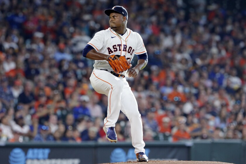Houston Astros starting pitcher Framber Valdez winds up during the first inning of the team's baseball game against the Texas Rangers on Saturday, July 24, 2021, in Houston. (AP Photo/Michael Wyke)