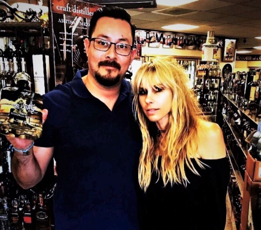 Elle France and her consultant Gonzalo Spindola at Old Town Liquor store.jpg