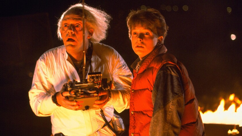 "Christopher Lloyd, left, and Michael J. Fox in the 1985 film ""Back to the Future."""