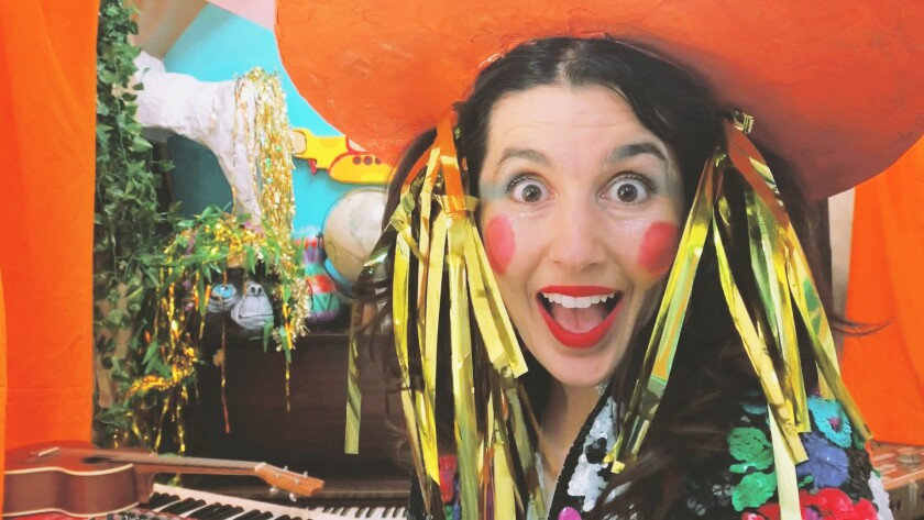 """Natasha Kozaily, owner of Kalabash School of Music and the Arts, dresses up as """"Miss Nati"""" to create educational lessons for kids about musical artists."""