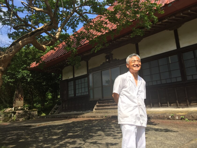 Yoshihiro Shibata visits the temple in Hara-izumi village, Japan. The last monk left years ago because donations were insufficient, given the village's dwindling population.