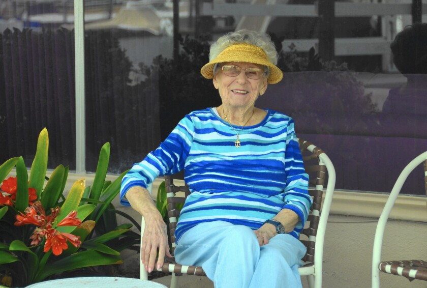 Ramona Merle, 101, sits on the patio of her bayfront home on Balboa Island in Newport Beach. Before moving into it full time in 1981, she and her husband, Ray, rented it to tenants for two years.