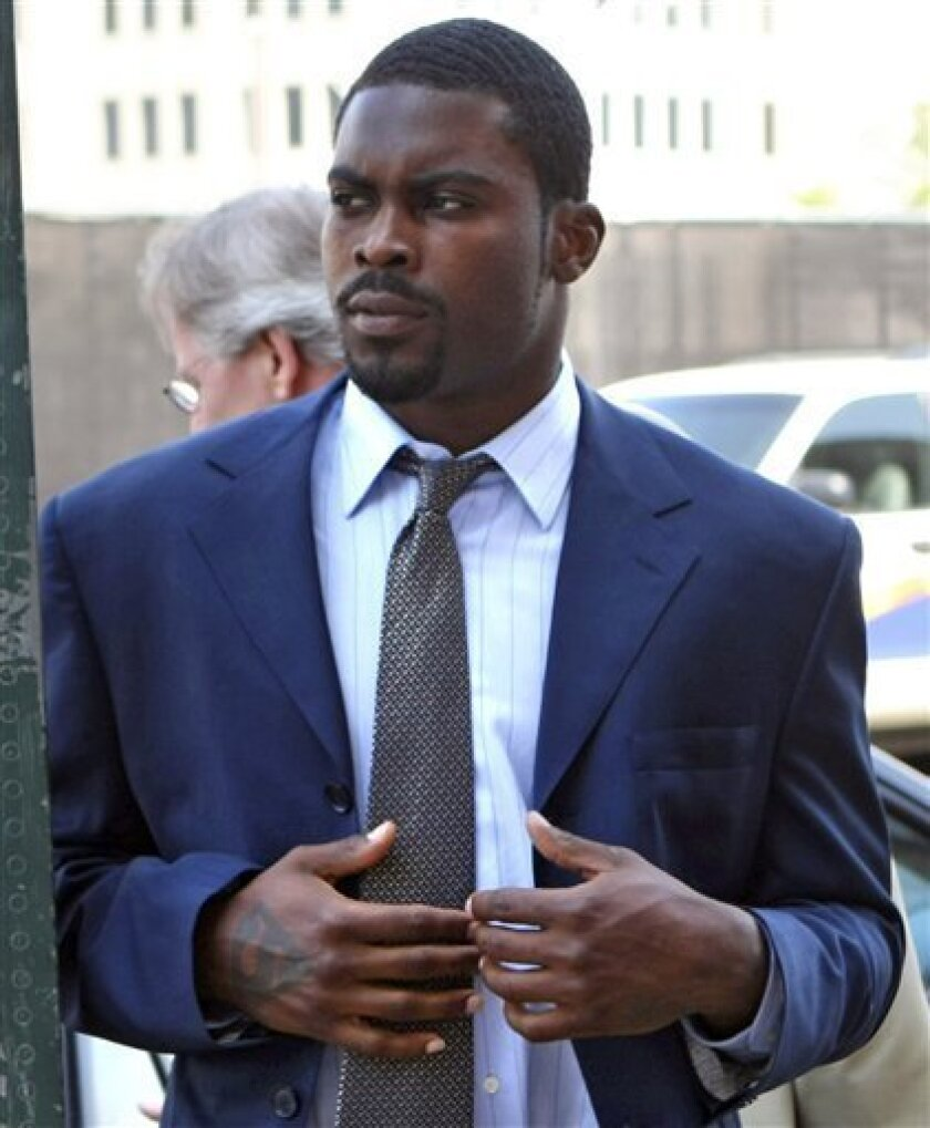 FILE - This June 9, 2009 file photo shows Michael Vick arriving at the Norfolk Federal Court n Norfolk, Va. Vick's lawyer, Paul Campsen, disclosed the basic outline of a new bankruptcy plan Tuesday June 30, 2009, in U.S. Bankruptcy Court in Norfolk. (AP Photo/Jason Hirschfeld, File)