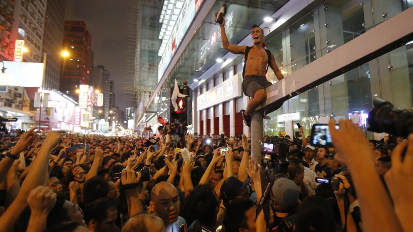 Pro-democracy protesters pack the streets in Hong Kong. But they do so at great risk.