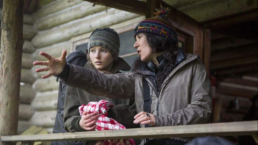 "Thomasin Harcourt McKenzie, left, and director Debra Granik on the set of ""Leave No Trace."""