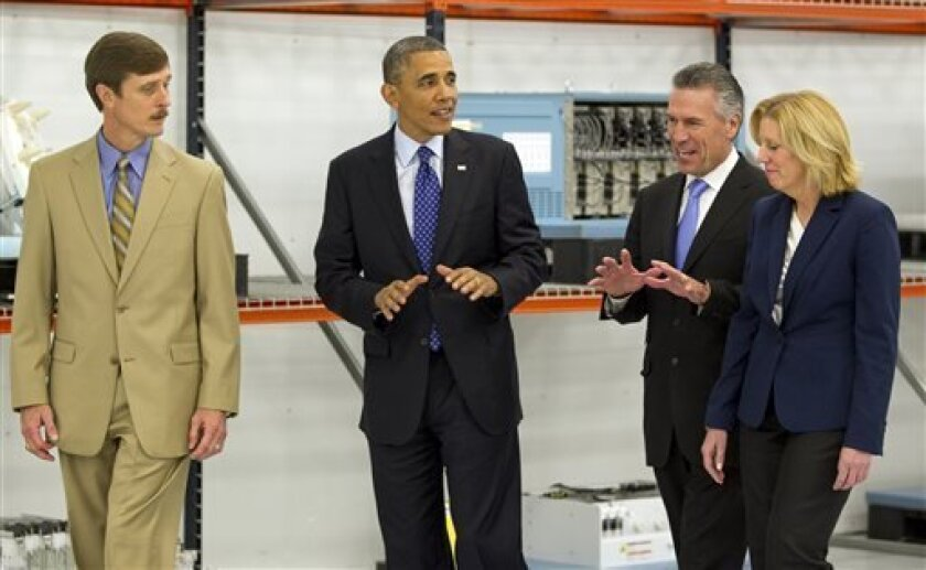 President Barack Obama tours Applied Materials Inc., with Rick Gesing, left, Mike Splinter, center, and Mary Humiston, right, during a visit to the facilities in Austin, Texas, Thursday, May 9, 2013. (AP Photo/Austin American-Statesman, Rodolfo Gonzalez, Pool)