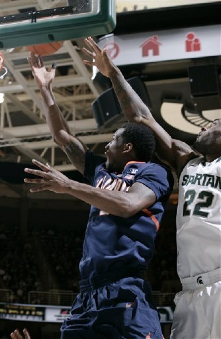 Illinois' D.J. Richardson, left, puts up a layup next to Michigan State's Branden Dawson (22) during the first half of an NCAA college basketball game, Thursday, Jan. 31, 2013, in East Lansing, Mich. (AP Photo/Al Goldis)