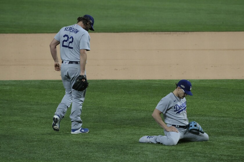 Dodgers pitcher Clayton Kershaw and second baseman Kiké Hernández fail to prevent an infield single.