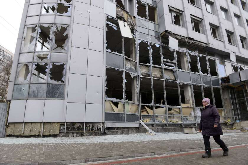 A lone pedestrian passes through a once-bustling area of Donetsk on Nov. 13. Commercial buildings, government offices and thousands of homes have been destroyed in the city in seven months of fighting between separatists and Ukrainian troops.