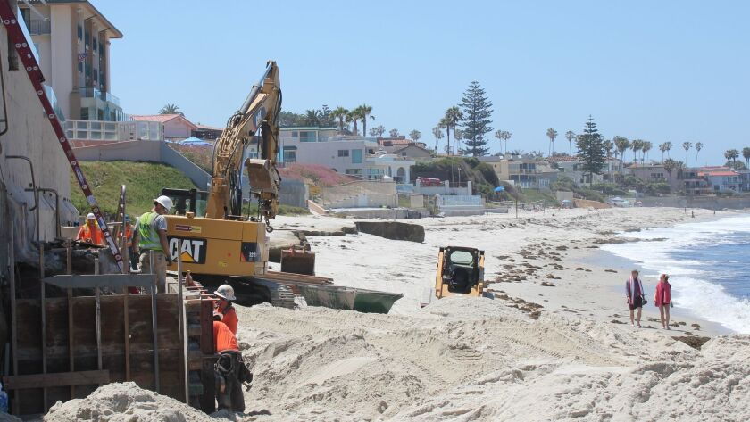 City of San Diego construction crews work away repairing the 100 Coast Blvd. stairs while beach-goer