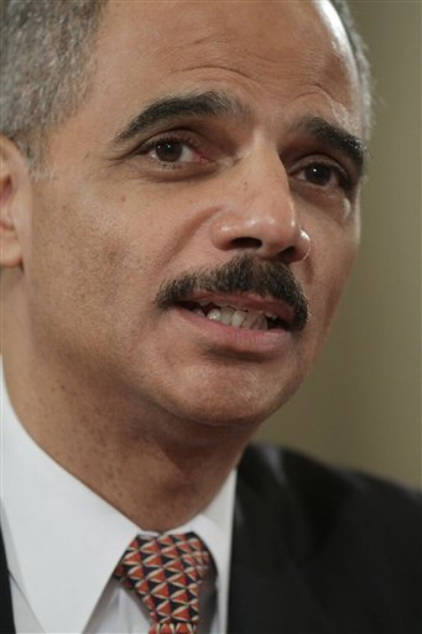 Attorney General-designate Eric Holder testifies on Capitol Hill in Washington, Thursday, January 15, 2009, before the Senate Judiciary Committee hearing on his nomination.  (AP Photo/Evan Vucci)