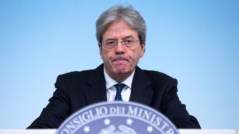 epa05894413 Italian Prime Minister Paolo Gentiloni addresses a press conference after the cabinet me