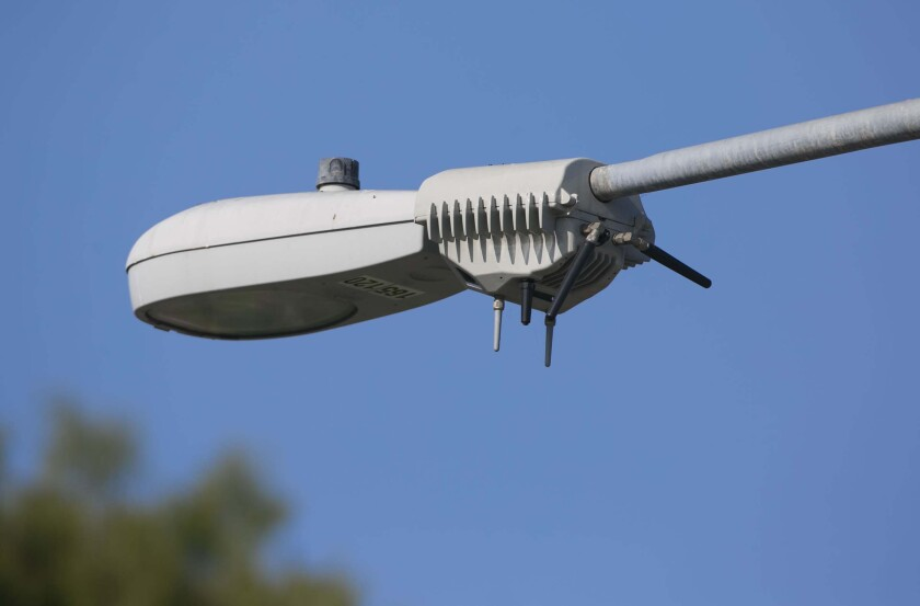"""A """"smart"""" streetlamp"""" mounted on the """"cobra head"""" style photographed in San Diego's  North Park neighborhood."""