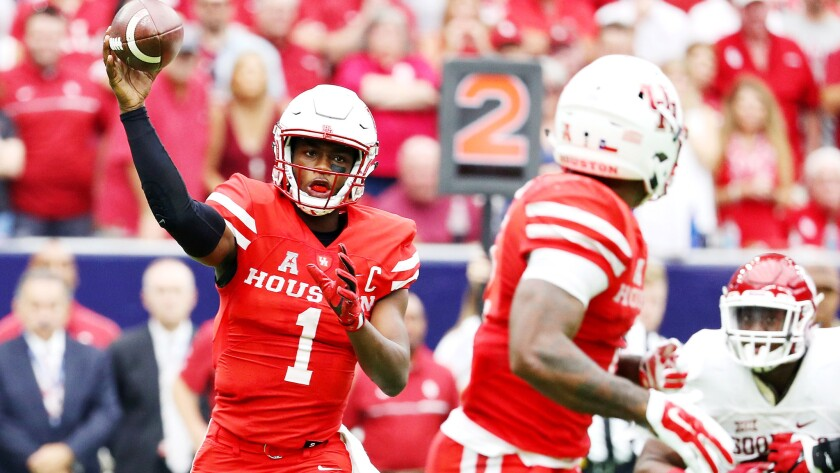 Quarterback Greg Ward Jr. swings a pass to a Houston teammate during their upset of Oklahoma on Saturday.