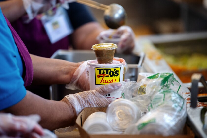 A to-go order being packaged at Tito's Tacos in Culver City